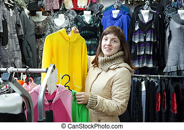 woman  chooses clothes