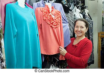 Woman  chooses clothes
