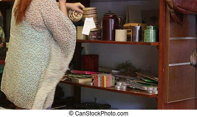 woman chooses decorative accessories in the store