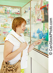 woman chooses enema at pharmacy