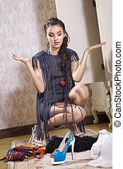 woman chooses shoes - beautiful young woman don't know what ...