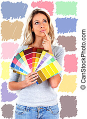 Woman choosing a color for painting.