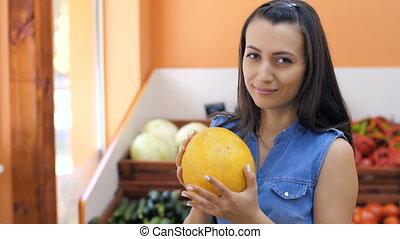 Woman Choosing a Melon