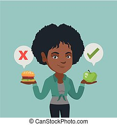 Woman choosing between hamburger and cupcake.