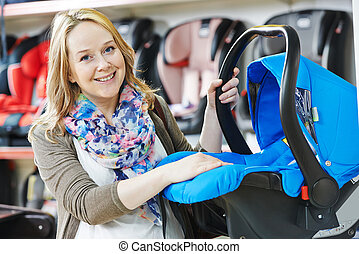 woman choosing child car seat