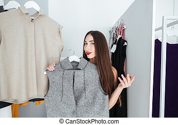 Woman choosing cloth in store