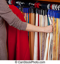 Woman choosing coloured fabric samples