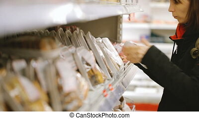 Woman choosing food at grocery store