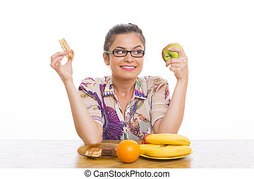 Woman choosing fruits