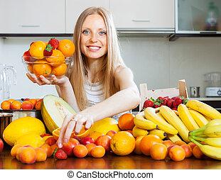 woman choosing fruits