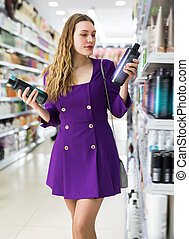 Woman choosing hair care products