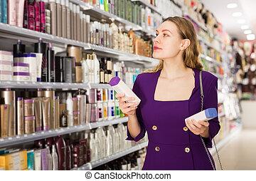 woman choosing hair care treatments