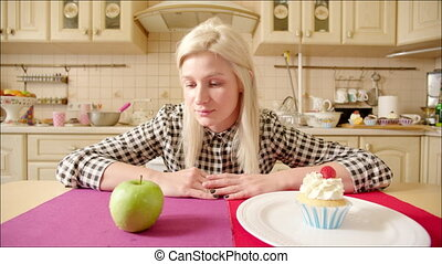 Woman choosing healthyor junk food