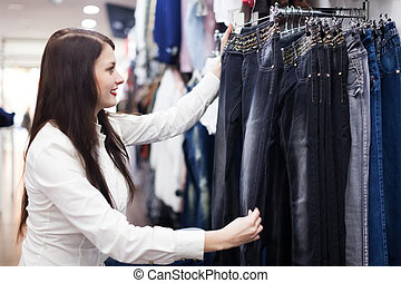 Woman choosing jeans