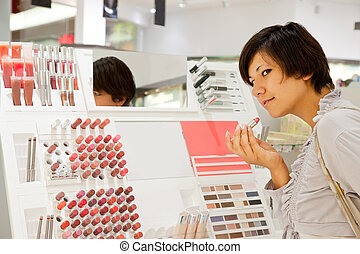 woman choosing lipstick