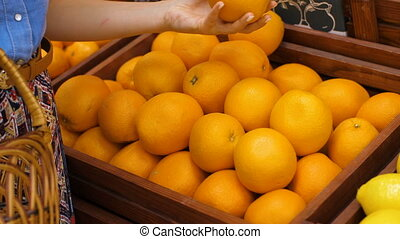 Woman Choosing Oranges