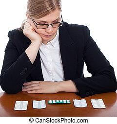 Woman choosing pharmaceuticals