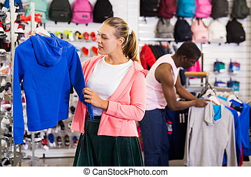 Woman choosing sportswear