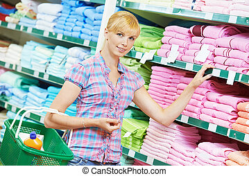 woman choosing textile linen in shop