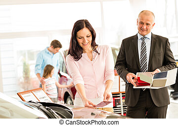 Young wife choosing the color of family car