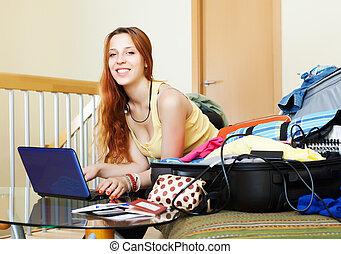 woman choosing the resort on internet
