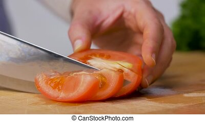 woman chopping tomato with kitchen knife at home - healthy ...