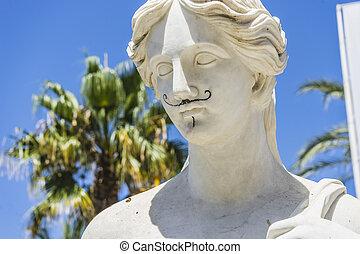 woman classic sculpture in white, marbella spain