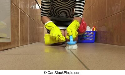 Woman clean bathroom floor