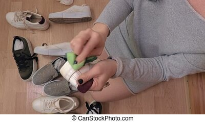Woman clean dirty sneakers