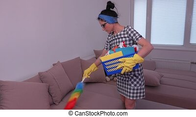 Woman clean dust from the sofa