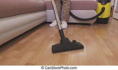 Woman clean floor with vacuum cleaner