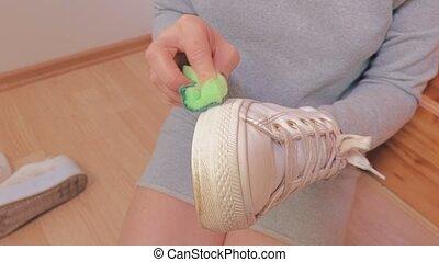 Woman clean sneakers