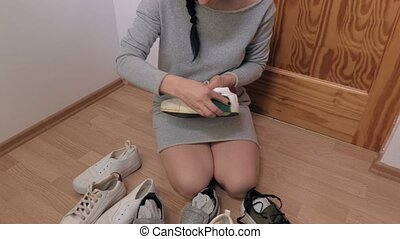 Woman clean trainers soles
