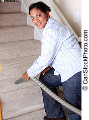 Woman Cleaning House - Woman cleaning in her house with a...