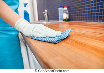 Woman Cleaning Kitchen Countertop - Closeup Of Young Woman...