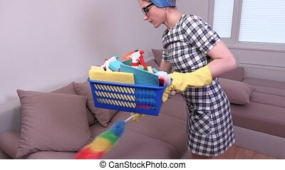 Woman cleaning sofa and take break