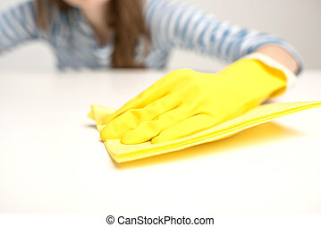 Woman cleaning surface - Partial view of female hand in...