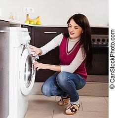 woman cleaning washing machine