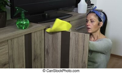 Woman cleans furniture door