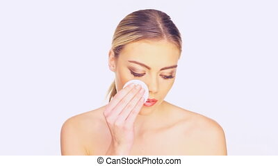 woman cleansing her face