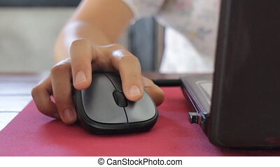 Woman click on wireless mouse