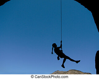 woman climber silhouette - silhouette of a woman rock...