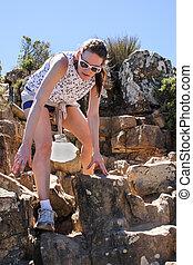 Woman Climbing down Lions Head