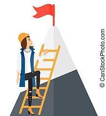 Woman climbing on mountain.