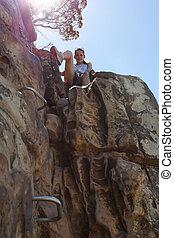 Woman Climbing Up Lions Head