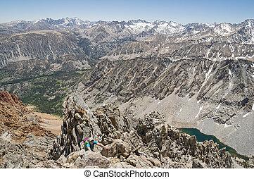 Woman Climbs Mountain