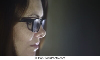 woman close face sideways glasses face looking to the light...