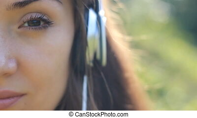 Woman closeup in headphones listening music. Sad melody and...