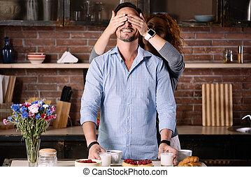 Woman closing eyes of his man