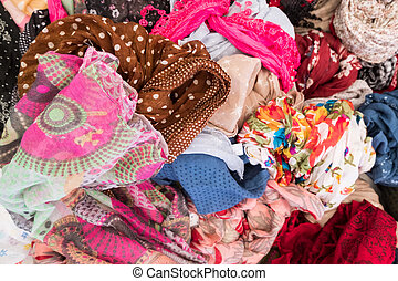 Woman clothes display at a street market store.
